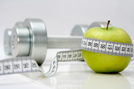 Apple and Weight Set with Tape Measure Around